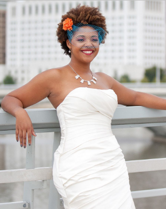 Tight Curls With a Birdcage Veil